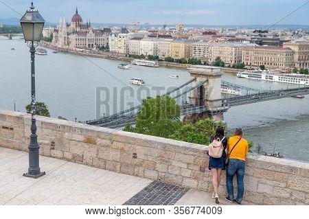 Budapest, Hungary - May 11, 2019: Couple Enjoying The Spectacular View Of Budapest, Hungary