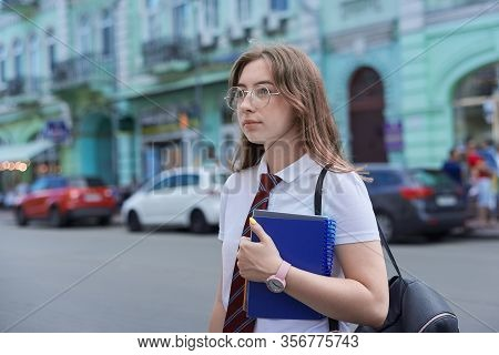 Girl 17, 18 Years Old High School Student In City Looking To Side, Copy Space. Female In Tie, Glasse