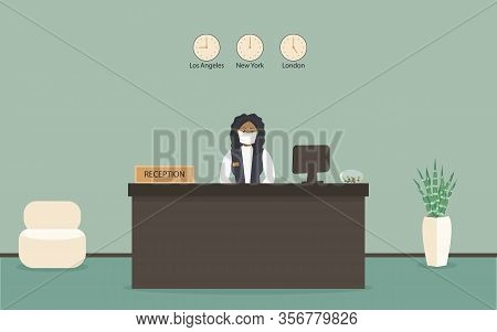 Receptionist Black Female In Protective Medical Mask Behind Workplace In Hotel Or Bank. Interior Of