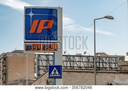 Palermo, Sicily - February 11, 2020: The Banner With A Logo Of Ip Gas Station In The Center Of The P