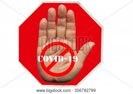 STOP SIGN. Coronavirus19. Coronavirus Stop Sign. Red USA Stop Sign with STOP COVID-19 and International NO Symbol on Human Hand. Isolated on white. Clipping Path. World Wide Pandemic from China.