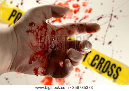 Closeup Of A Victim At A Crime Scene With Bloody Hands.