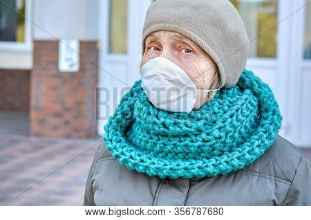 An Old Woman Near The Hospital Door In A Protective Mask On Her Face In Full Growth. Medical Help Ol