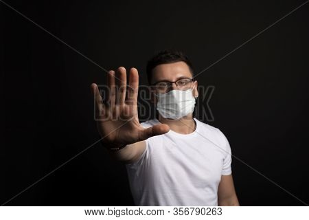 Coronavirus Stop Concept.man In Wearing Mask For Protect And Show Stop Hands Gesture For Stop Corona