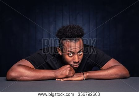 Handsome Skeptical Black Man Looking Up And Into Camera