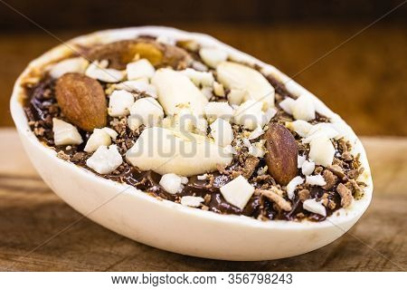 Easter Egg From Brazil, Filled With Brazil Nuts And Chocolate. The Chestnut Is Known As