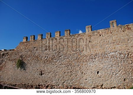 The medieval fortified wall of Alcudia Old Town on the Spanish island of Majorca.