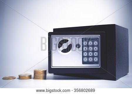 Safe Deposit. Symbol Of Money Accumulation And Safety. Small Residential Vault With Coins. Toned Sof