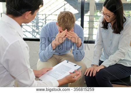 Phychiatrist Phychologist Counselor Therapist Consulting Giving Relationship Advice To Couple. Marri