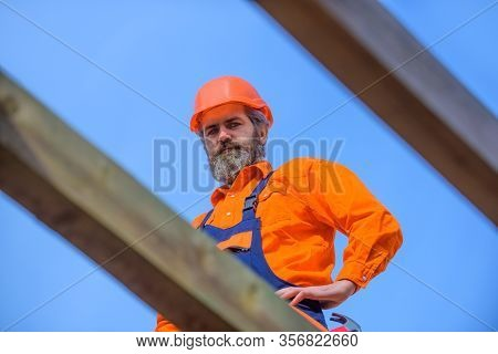 Business, Building Concept. Man Builder Working On Roof Of House. Worker Roofer Builder Working On R