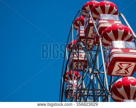 Amusement Ride Against Blue Sky. Skydiver (ferris Wheel) In A Amusement Park In Bucharest .