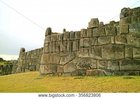 Ruins Of Ancient Inca Huge Stone Wall Of Sacsayhuaman Fortress, Archaeological Site In Cuzco, Peru,