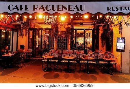 Paris, France- March 12, 2020 : Located In The 1st Arrondissement, Cafe Ragueneau Rubs Shoulders Wit