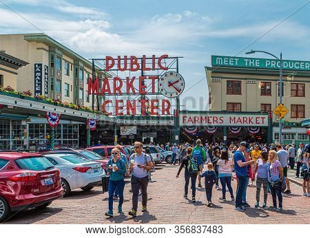 Seattle, Washington - July 4, 2019: Pike Place Market Is A Public Market Overlooking The Elliott Bay