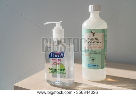 CANADA- MARCH 15. Corona virus COVID-19 Purell hand sanitizer gel rub and 70% rubbing alcohol antiseptic cleaner sanitizing bottle for sale on store shelf in Canada March 15 2020.