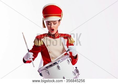 Drummer In A Red Uniform Drums On A Drum, Show Program And Celebration. White Background. Funny Drum