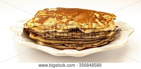 Pancakes Top View Stack On White Color Vintage Plate Isolated On White Background Close Up. Selectiv