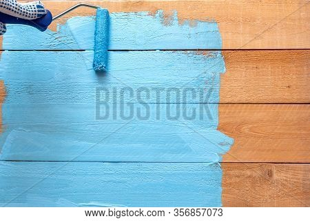 Painting With The Paint Roller Blue Color Paint On The Green Paint Tray On The Wooden Diy Background