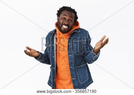 Carefree, Relaxed And Unbothered Stylish African-american Man In Denim Jacket, Orange Hoodie, Raisin