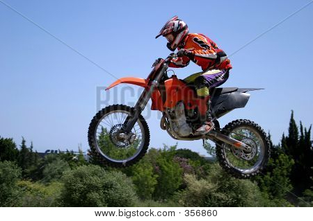 Red And Orange Moto X Or Motor Cross Bike Giving Big Air On Dirt