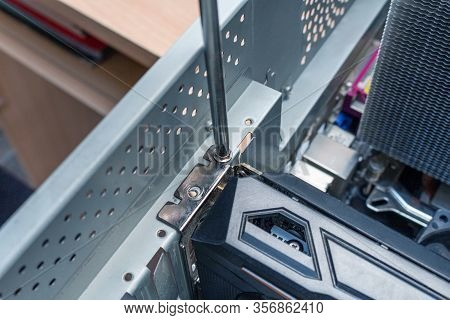 Screwing Pci Express Video Card On A Place In The Service