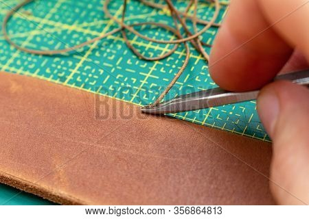 Beveling Cutting Edge On The Brown Leather Stripe For Belt With Special Tool