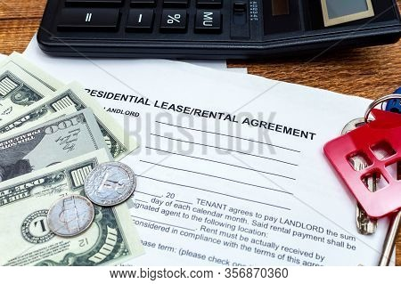 House, Home, Property, Real Estate Lease Rental Contract Agreement Pen Money Coins Keys Wooden Backg