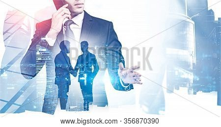 Two Businessmen Shaking Hands In Blurry Night City With Double Exposure Of Their Colleague Talking O