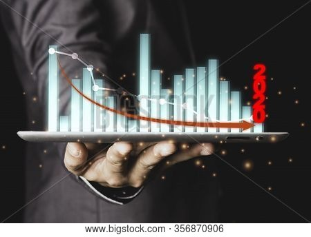Closeup Of Executive Businessman Holding And Giving Financial Graph Or Chart 2020 Year Which Economi
