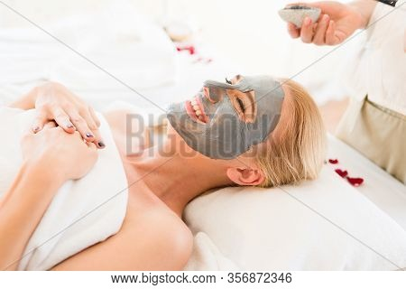 Close Up Shot Of Relax Beautiful Middle-aged Women Feeling Exiting From Having A Clay Mask Treatment
