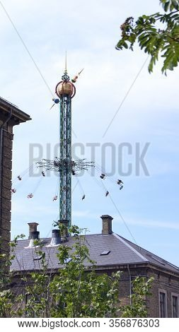 Copenhagen, Denmark - Jul 05th, 2015: Swinging Fair Ride On Tivoli Amusement Park At Copenhagen