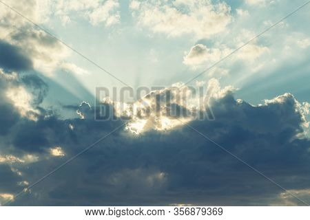 Dramatic Picturesque Colorful Sky With Cloud And Picturesque Scenic Feather Sunbeams Before Sunset