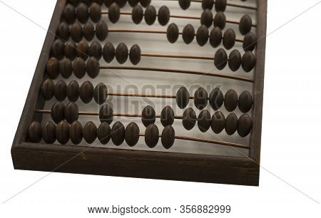 Old Wooden Scores. Close-up Abacus . Abacus On Light And Brown Background. Concept Of Savings, Count