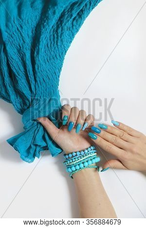 Fashionable Oval Long Nails With Different Shades Of Nail Polish From Light Blue To Turquoise. Creat