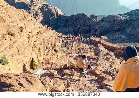 Sinai Peninsula, Egypt, May 9, 2019: Tourists Descend From Mount Moses At Sunrise.