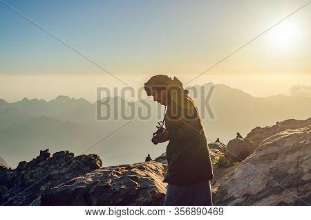 Sinai Peninsula, Egypt, May 9, 2019: A Man With A Camera On Mount Moses.