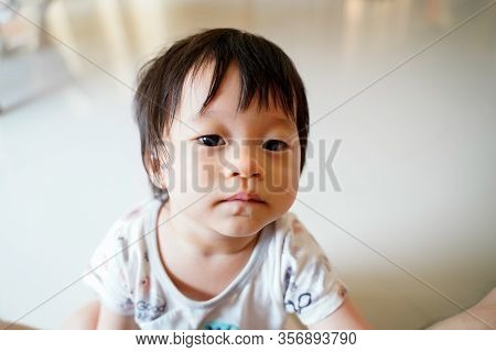 Close Up Toddler Is Curious Keep Thinking And Look Innocent In Living Room, Child And Toddler Concep