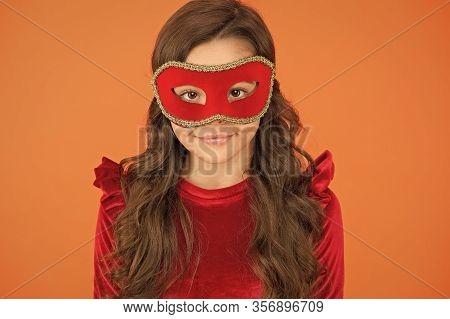 Going To Masked Ball. Little Child Wear Masquerade Mask. Happy Girl In Venetian Eye Mask. Festival M