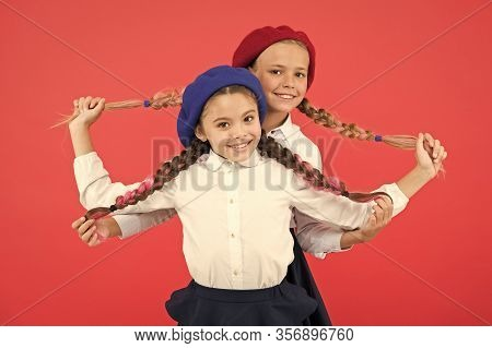 Best Braided Hairdo. Small Girls Being Proud Of Long Braid Hairdo On Pink Background. Little Kids Ho