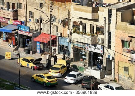 Amman, Jordan - February 15, 2020. View To The Residential Area And Street Life At Sunset Of The Cit
