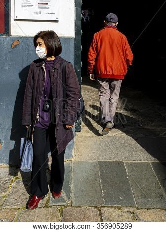 Seville, Spain  - March 7: Unidentified Woman Wearing Mask To Protect Herself And Others From Corona