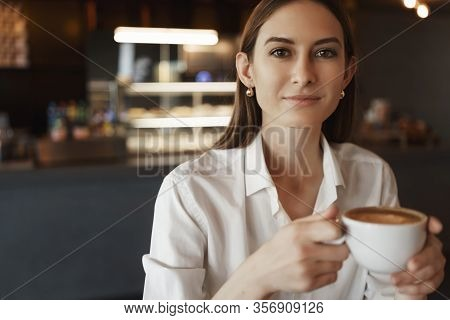 Close-up Portrait Of Successful Young Female Business Coach Prepare Speech Presentation In Cozy Cafe