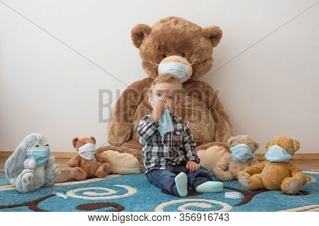 Child Playing With His Sick Teddy Bears Wearing Medical Mask Against Viruses. Role Playing, Child Pl