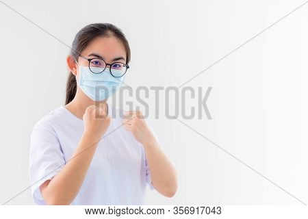 Portrait Asian Young Woman Wear A Mask To Protect Against Coronavirus, Girl Raise Fists Encourage To