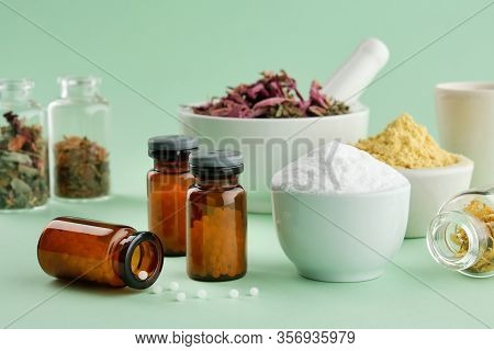 Bottles Of Homeopathic Drugs, Herbal And Mineral Ingredients And Substances For Preparation Of Homeo