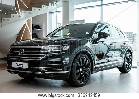 Novosibirsk, Russia - March 09, 2020:  Black Expensive Volkswagen Touareg, Front View.  New Modern C