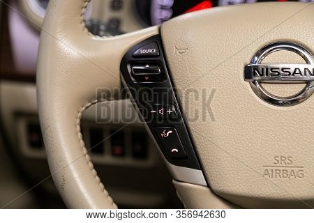 Novosibirsk, Russia - January  31, 2020:  Nissan Teana, Close-up Of The Multiwheel With Phone Settin