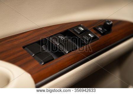 Novosibirsk, Russia - January  31, 2020:  Nissan Teana, Closeup Of A Door Wood Control Panel In A Ne