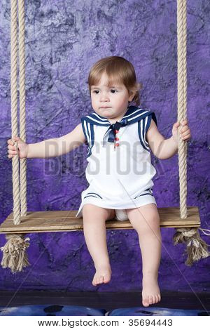 little girl in a dress in sailor's style