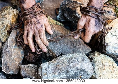 Hands Of A Humble Slave Who Is Not Trying To Free Himself Against A Dark Background, The Concept Of